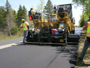 Pike Industries employs a CAT 1055D with a Carlson IV screed to place a ¾- to 1-inch overlay on Route 114 in Norton, Averill and Canaan.
