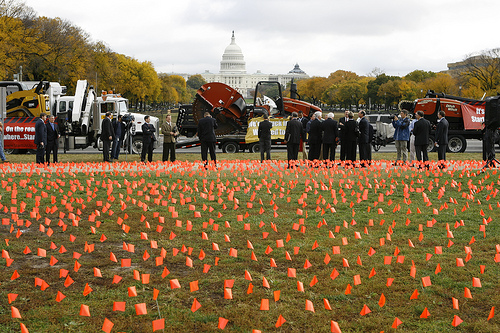 A sea of 5,500 orange flags, each one representing 100 jobs already lost in the construction equipment industry.