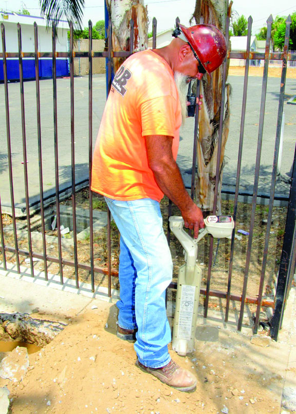 Ralph Torres of Long's Directional Boring checks the progress of the bore.