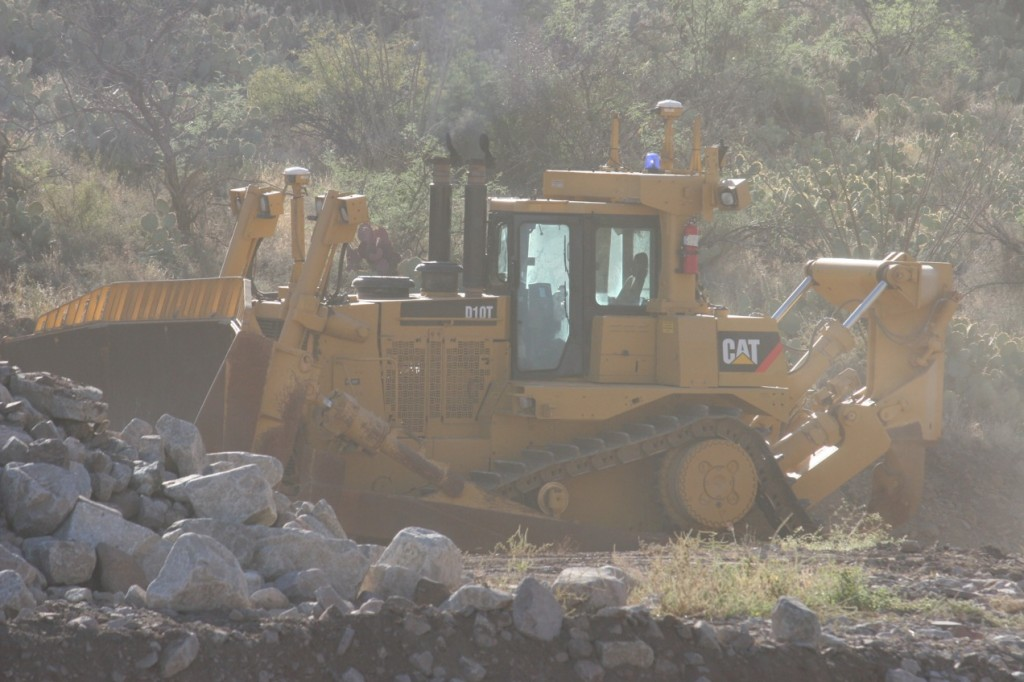 Note that the D 10 T dozer is being run without an operator. The operator is contrlooing the