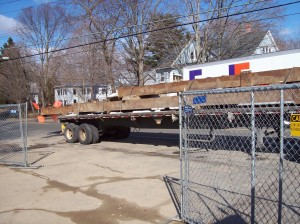 An AMCO tractor trailer hauling the 60 foot and 36 foot long wales.
