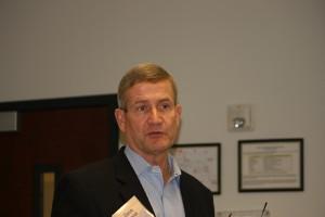 David W. Grzelak, Chairman and Chief Executive Office, Komatsu America Corp.