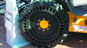 No, this is not a Tweel, it is a solid ire with apertures and as such is still a bottom-loading tire.