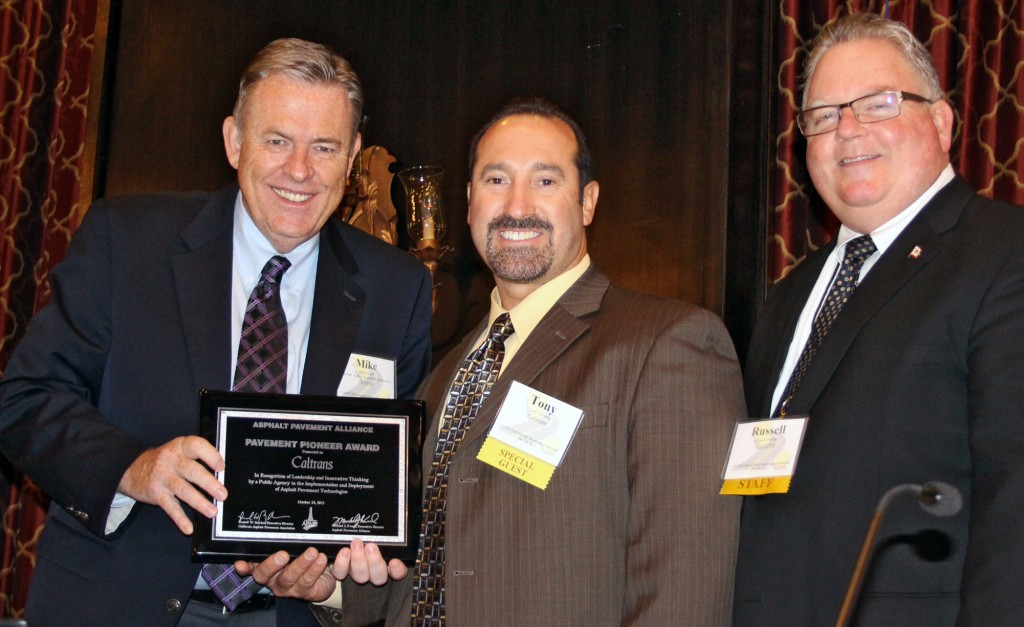 National Asphalt Pavement Association President Mike Acott (left) and California Asphalt Pavement Association Executive Director Russell Snyder (right) present the Pavement Pioneer Award to Caltrans Maintenance Chief Tony Tavares