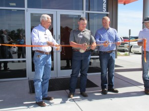 (Pictured left to right) Lenny Sadler, CEO, Josh McKown, Branch Manager, and Jake Sadler, COO, participate in a ribbon-cutting ceremony during a Ditch Witch UnderCon open house for the company's new dealership in Park City, Kansas.