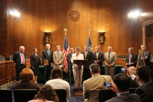 Public Works Committee Chairman Barbara Boxer (D-California) and Tim Watters (to the right of Boxer) at a recent conference in Washington D.C.