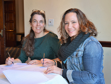 Sigrid de Vries, CECE secretary general (left), and Megan Tanel, AEM senior vice president, sign CECE International Exhibition Partnership Programme agreement during AEM's recent annual conference of member companies.